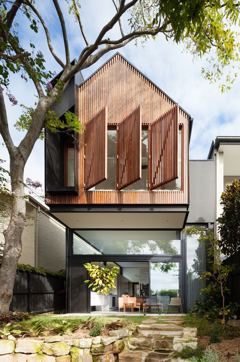 This House In Australia Received A Cantilevered Extension With Wood Window Shutters Facade House Architecture Eco House Design