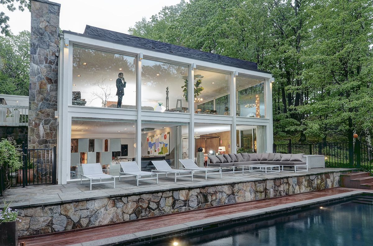 Knockout midcentury house in connecticut asks 1 8m curbedclockmenumore arrow glass walls galore