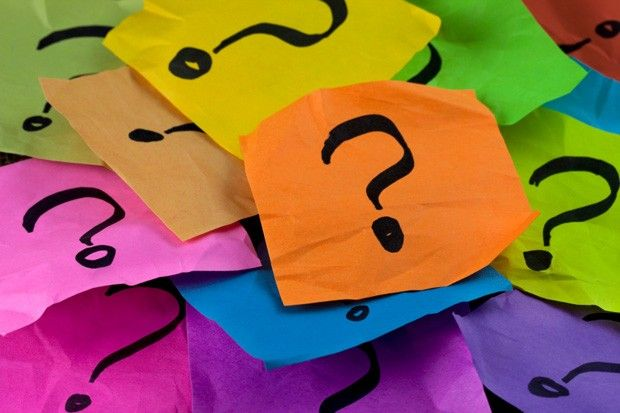 Questions, Decision Making Or Uncertainty Concept   A Pile Of Colorful  Crumpled Sticky Notes With Question Marks