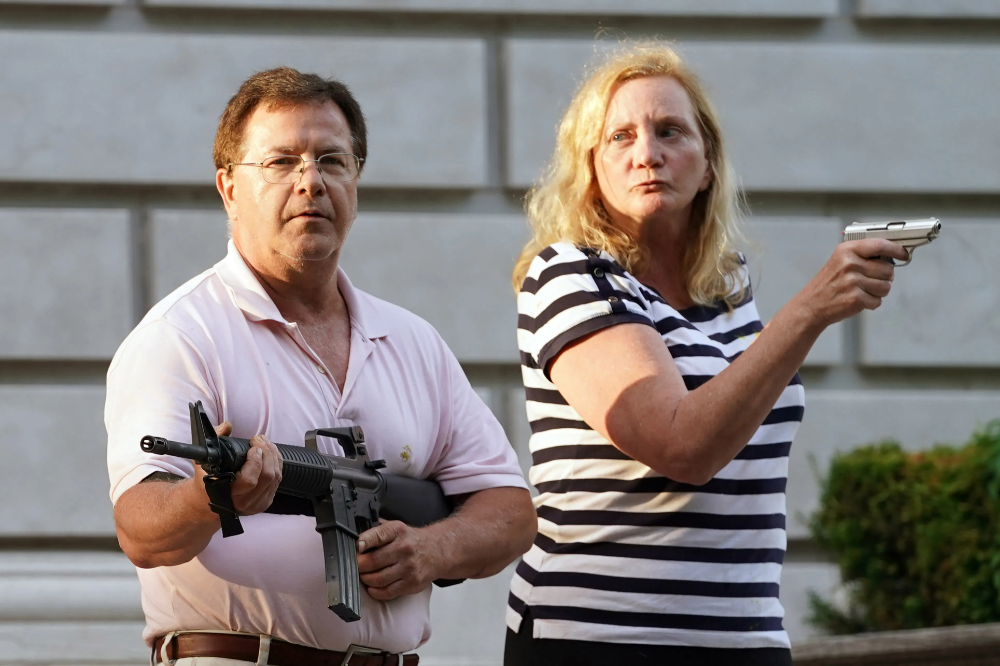 The St Louis Couple That Shot To Viral Infamy When They Pointed Guns At Black Lives Matter Protesters Outside Their Mansion A Mean Girls St Louis Mean Girls 2