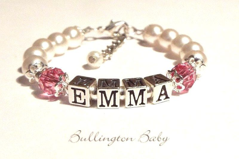This new bracelet from Chelle Bullington is just gorgeous! It has your little one's name spelled out in sterling silver letter blocks and Swarovski crystals in their birthstone color. It also has white Swarovski crystal pearls and small sterling silver beads. It has a one inch sterling silver ext...