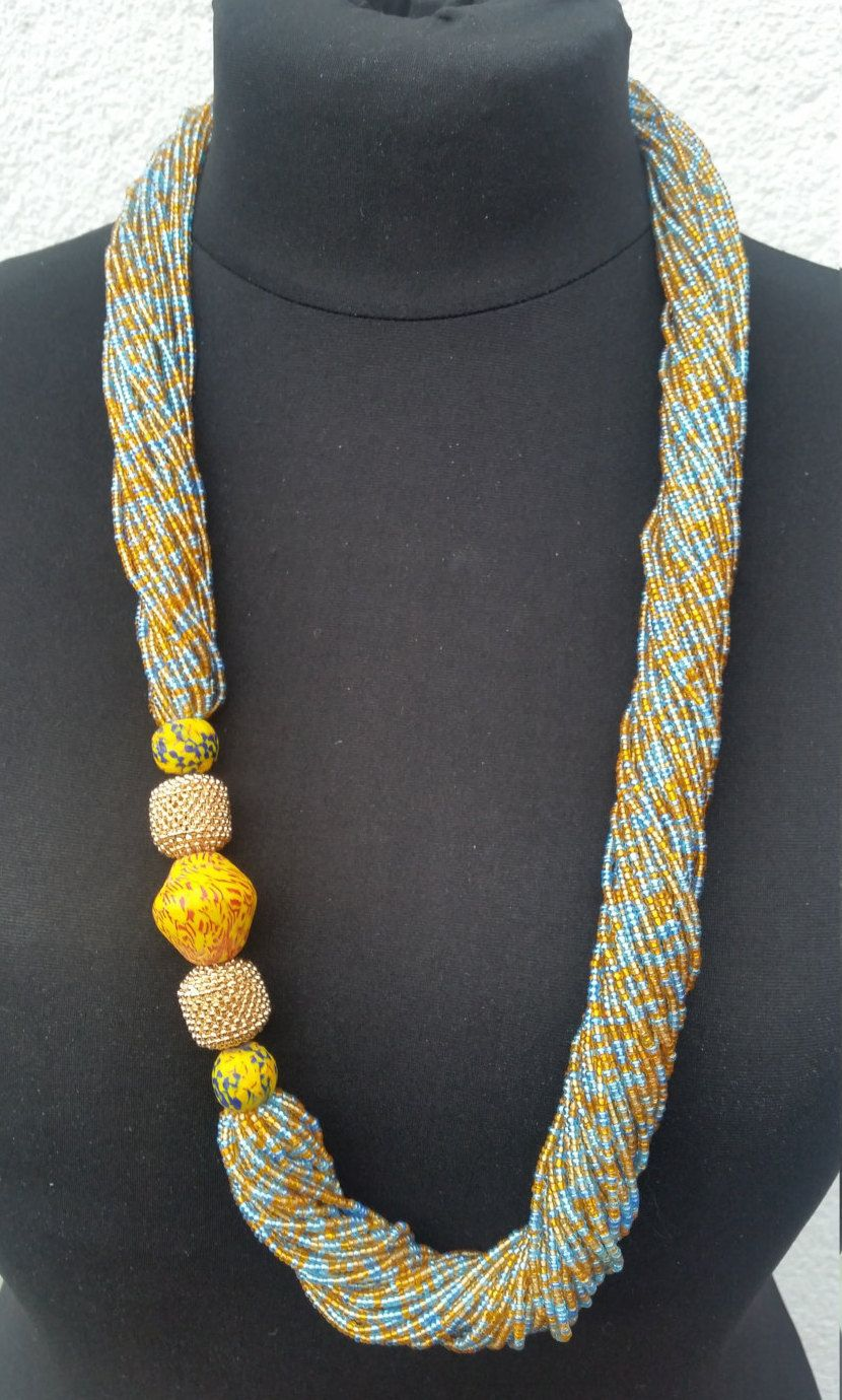 Long twisted seed bead strand necklace (blue, gold and orange) with a  traditional Ghanaian Clay Bead side feature | Large bead necklace, African  beads necklace, Statement jewelry necklace