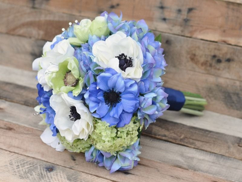 Anemone & hydrangea bouquet in shades of blue, ivory and apple green with rhinestone accents.  Photography by Adair Design Haus. adairdesignhaus.com See more here: http://www.hollysweddingflowers.com