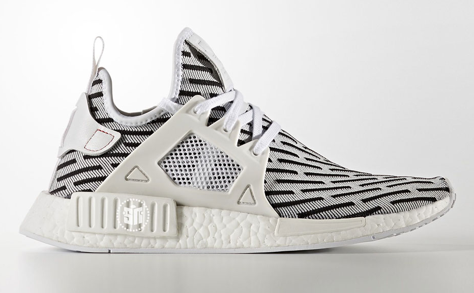 51171b1bbbaa The popularity of the extremely limited edition adidas Yeezy Boost 350 V2  Zebra inspired this latest iteration of the adidas NMD XR1