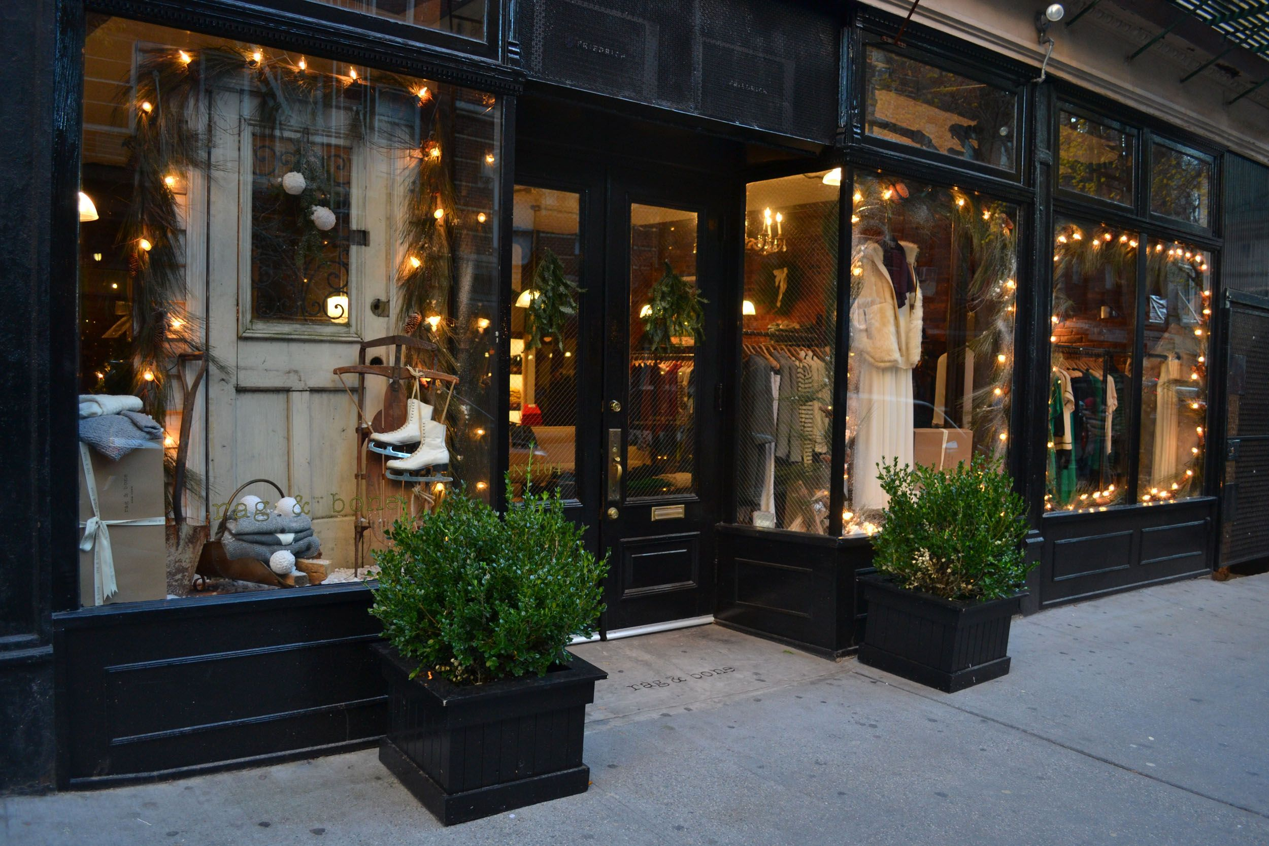 This is my kind of storefront! Boxwoods...light strands and ... Rag House Plans on