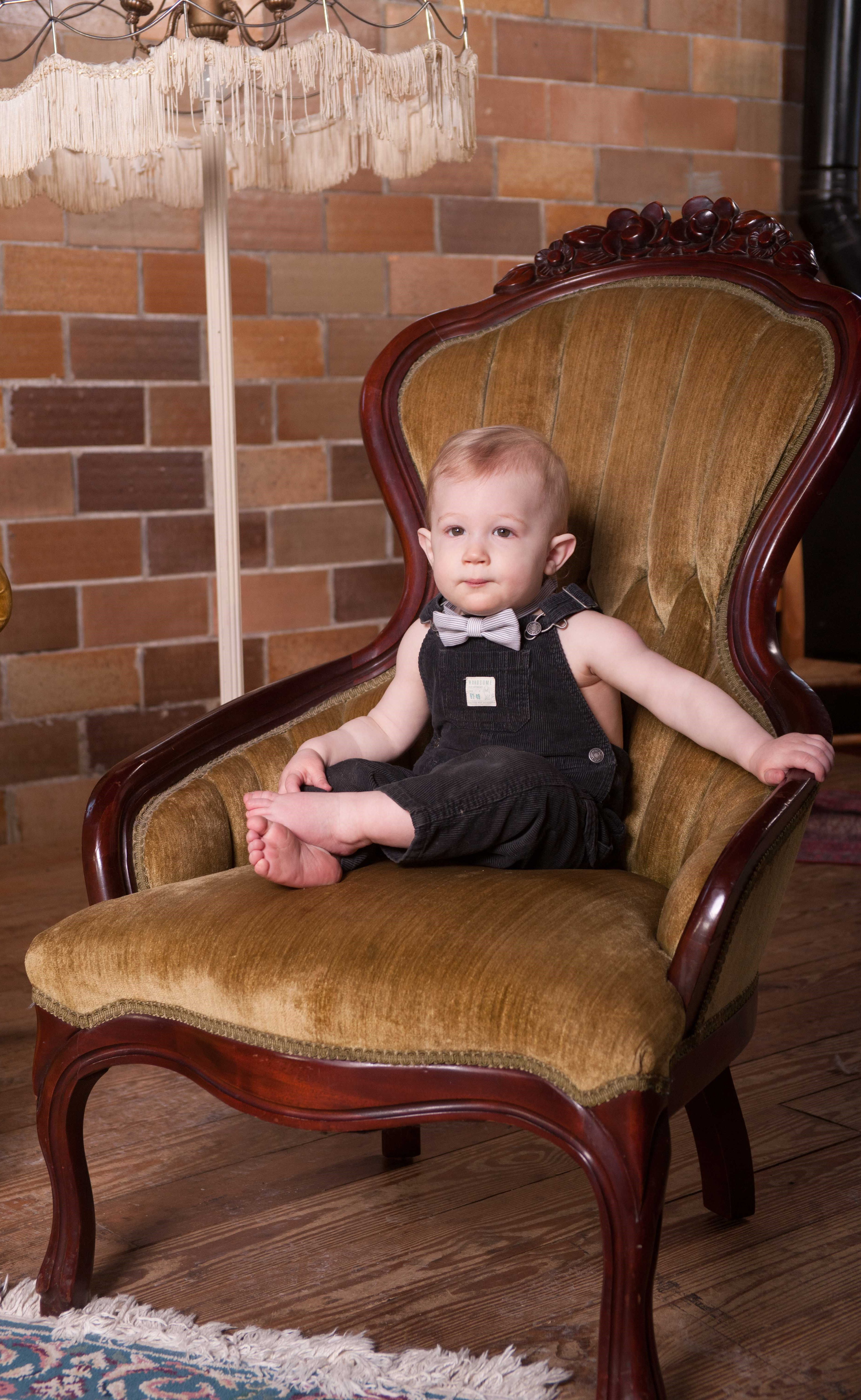 Sweet Little Boy In A Victorian Chair Wearing Bibs And A Bow Tie Victorian Chair Chair High Chair