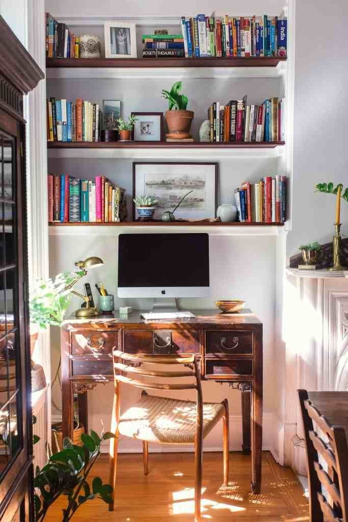 Small Home Office Alcove: This cozy home office makes use of a small alcove & benefits from natural light whilst the shelves create a ton of handy vertical storage space. Using an alcove as a home office allows the desk to be unobtrusive thanks to being set back in the room.