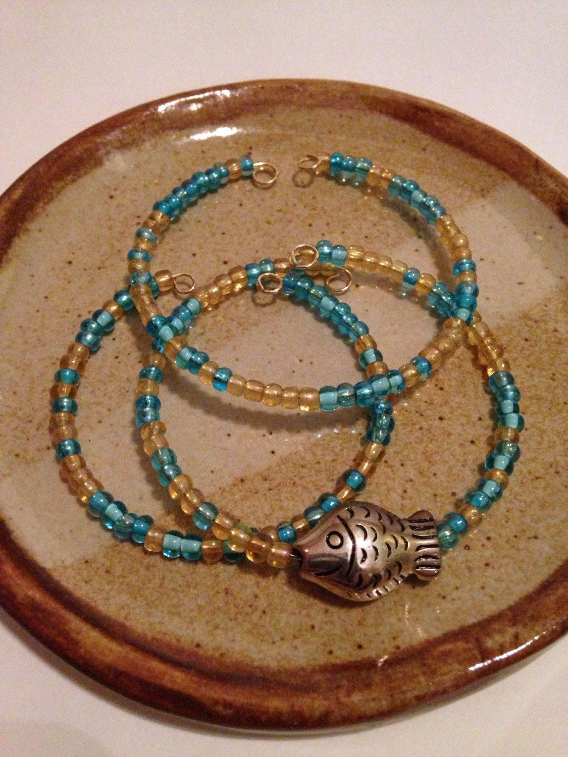 A personal favorite from my Etsy shop https://www.etsy.com/listing/230524372/yellow-and-blue-fish-beaded-bracelet