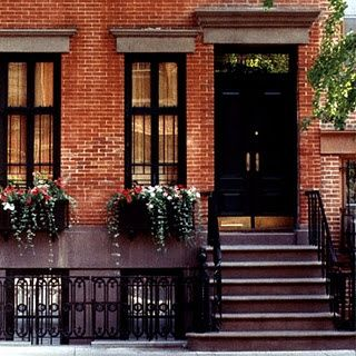 Red Brick House With Black Front Entry Door With Black