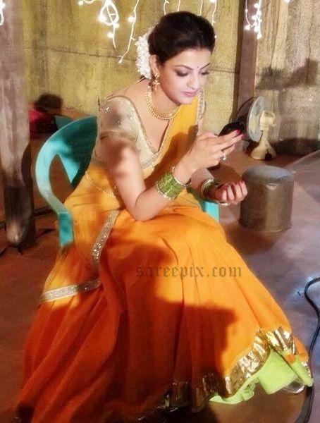 Kajal Agarwal In Orange Half Saree Images From Maari Movie Half Saree Half Saree Designs Saree Photoshoot