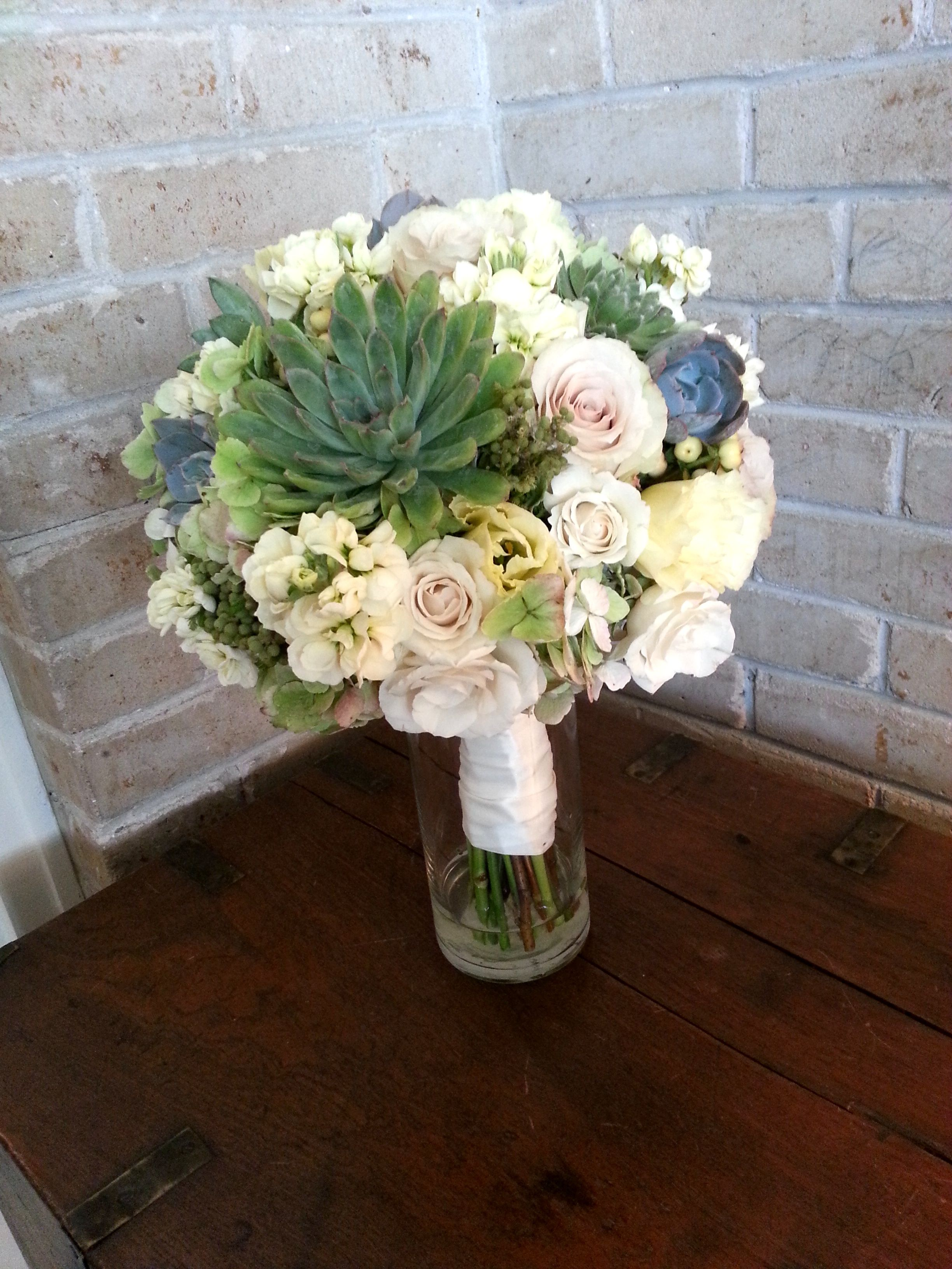 A beautiful succulent studded bouquet.  Flowers by Eden's Echo