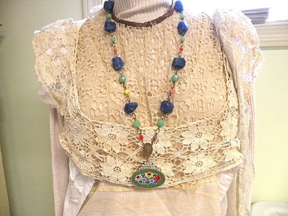Gorgeous necklace featuring a yummy vintage floral micro mosaic pin (back removed) adorned with vintage rhinestones , a vintage rosary center connector , natural sodalite nuggets and yummy glass beads.    approx. 29  approx 2 7/8   from top of center connector to bottom of floral.  approx 2 wide on floral    ref-meadow