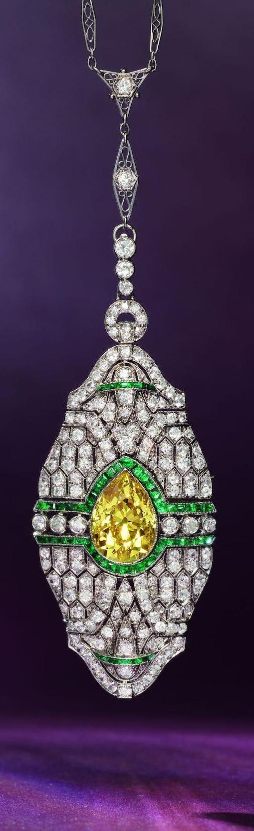 A rare belle epoque fancy coloured diamond diamond and emerald