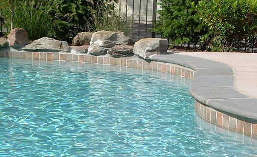 Pool Tile And Coping Ideas remodeled pebble tech pool with integrated spa added stacked stone cement coping built Find This Pin And More On Pool Deck Tile And Lighting