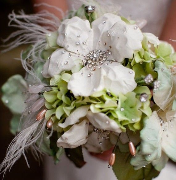 Vintage brooch and silk-flower bouquets from Noaki.