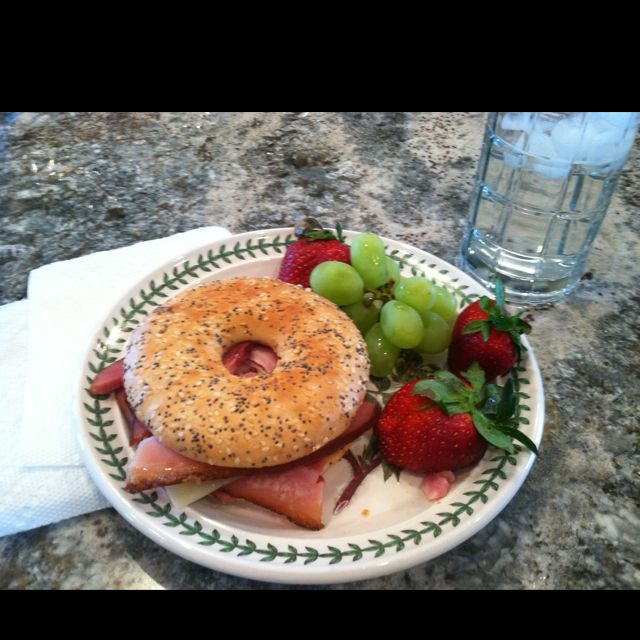 Lunch - honey baked ham with Swiss cheese and spicy brown mustard on a toasted everything bagel thin. Grapes and strawberries on the side with water to drink.