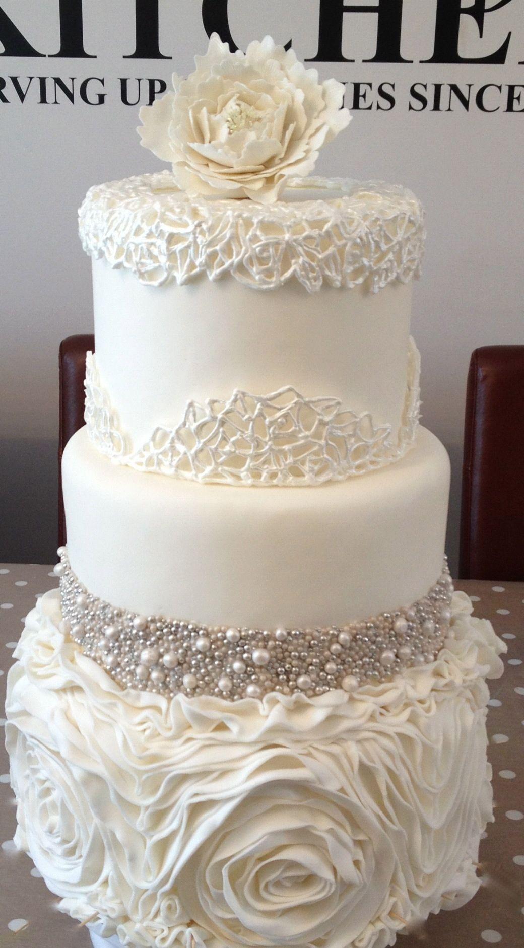 This cake! Fondant ruffles, hand rolled sugar pearls, Royal icing ...