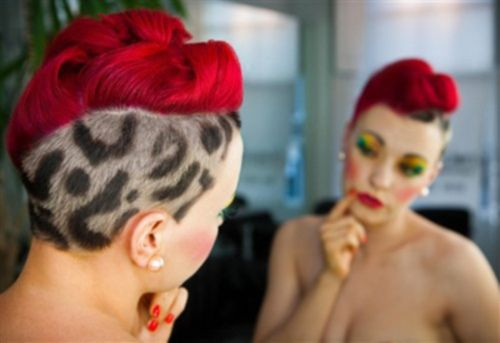 rockabilly leopard print and red curled hair