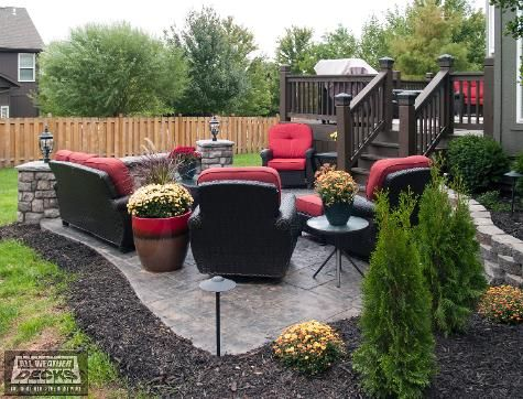 Stamped Concrete Patio With Stone Sitting Walls With