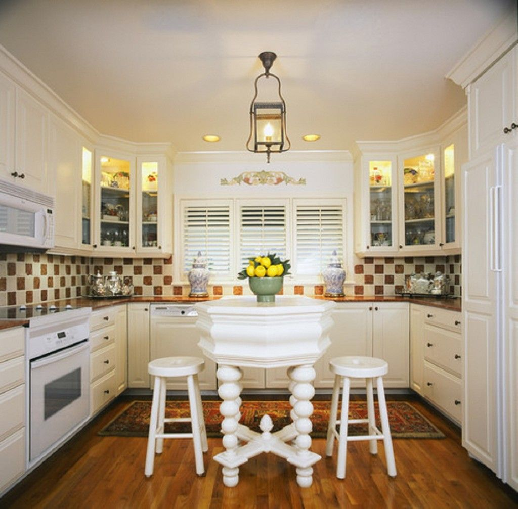 cabinets, window blinds and backsplash are charming. i might go with ...