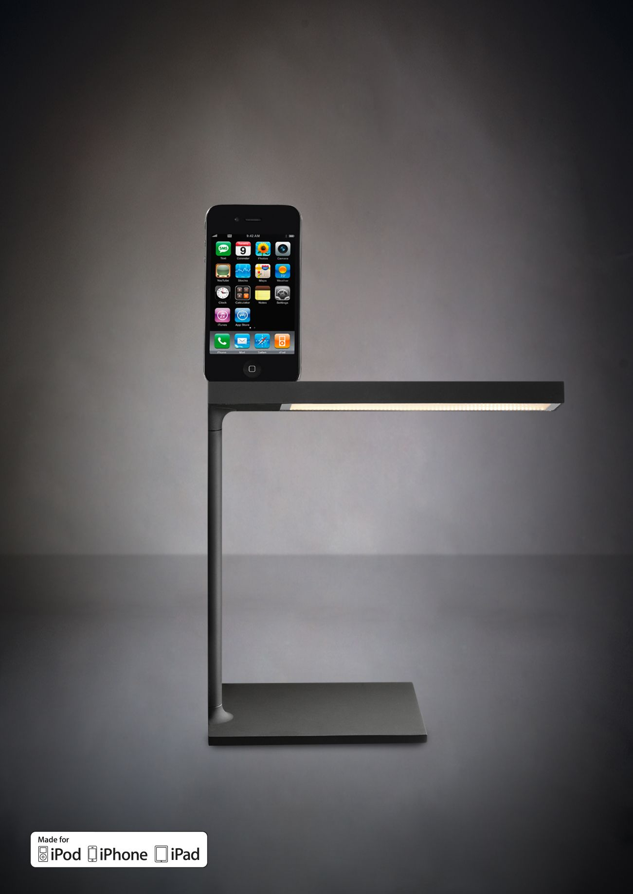 The D'E-Light Table Lamp - A sleek LED desk lamp and docking station for iPad/iPhone in one from Philippe Starck and Flos.