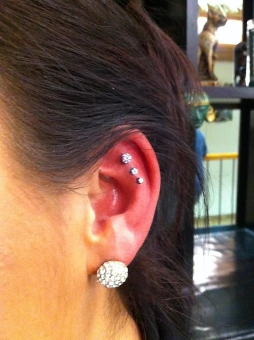 fuknoscar:  Triple Helix Piercing with NeoMetal jewelry in pink and cubic zirconia gems.