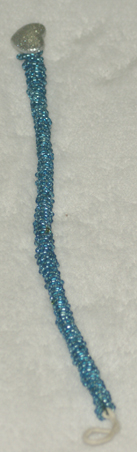 Hand beaded bracelet with silver heart closure. 9.5 in, long