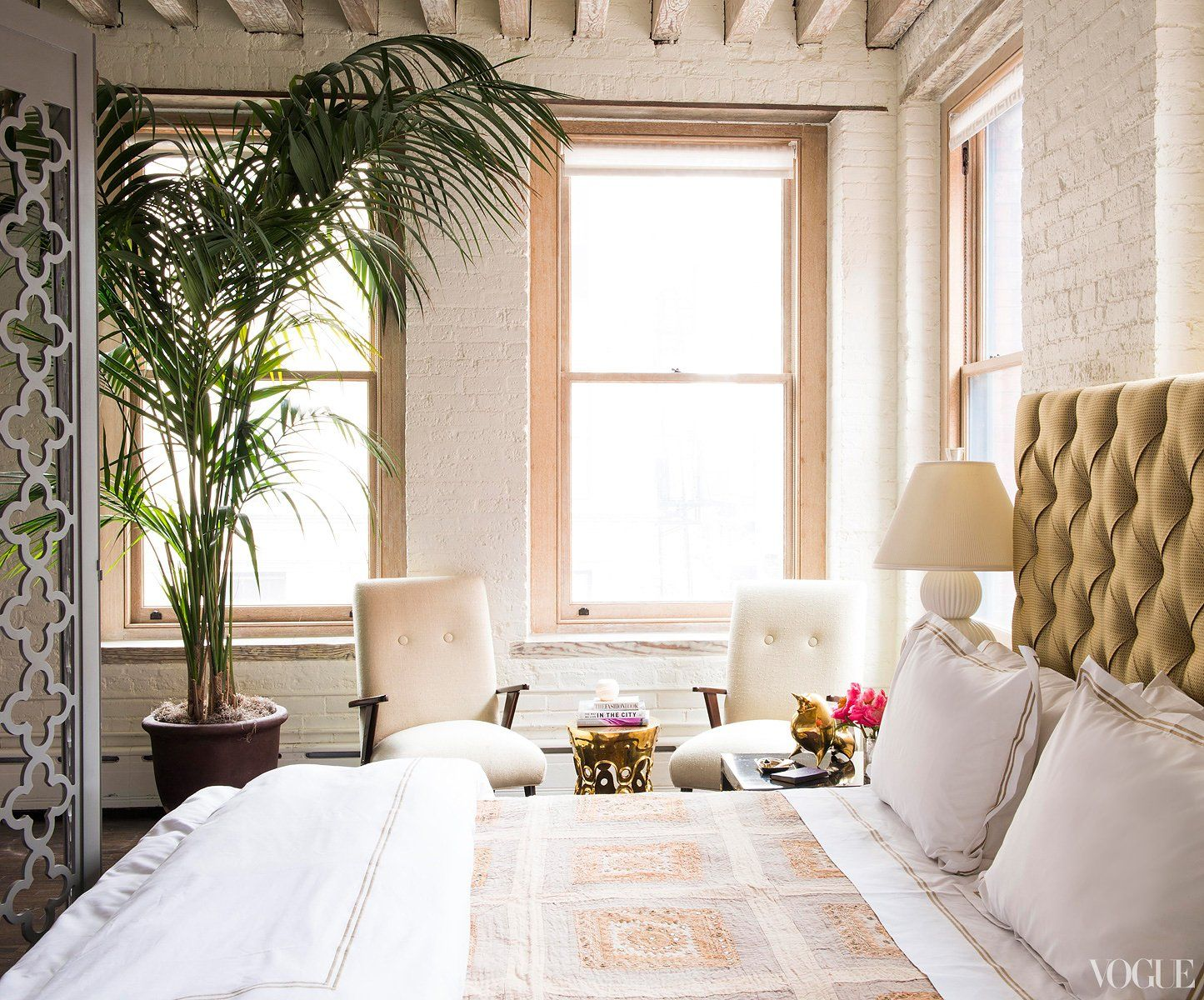Rest Easy - Two Italian Boomerang chairs from the sixties are paired in front of the window to create a cozy seating area where I can read or enjoy the view. My bed is custom-made in upholstered silk, topped with an Indian throw.
