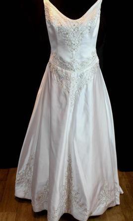 Demetrios, find it on PreOwnedWeddingDresses.com $245 white used size 20