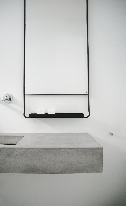 interior design: bathroom simplicity, concrete + cool mirror and