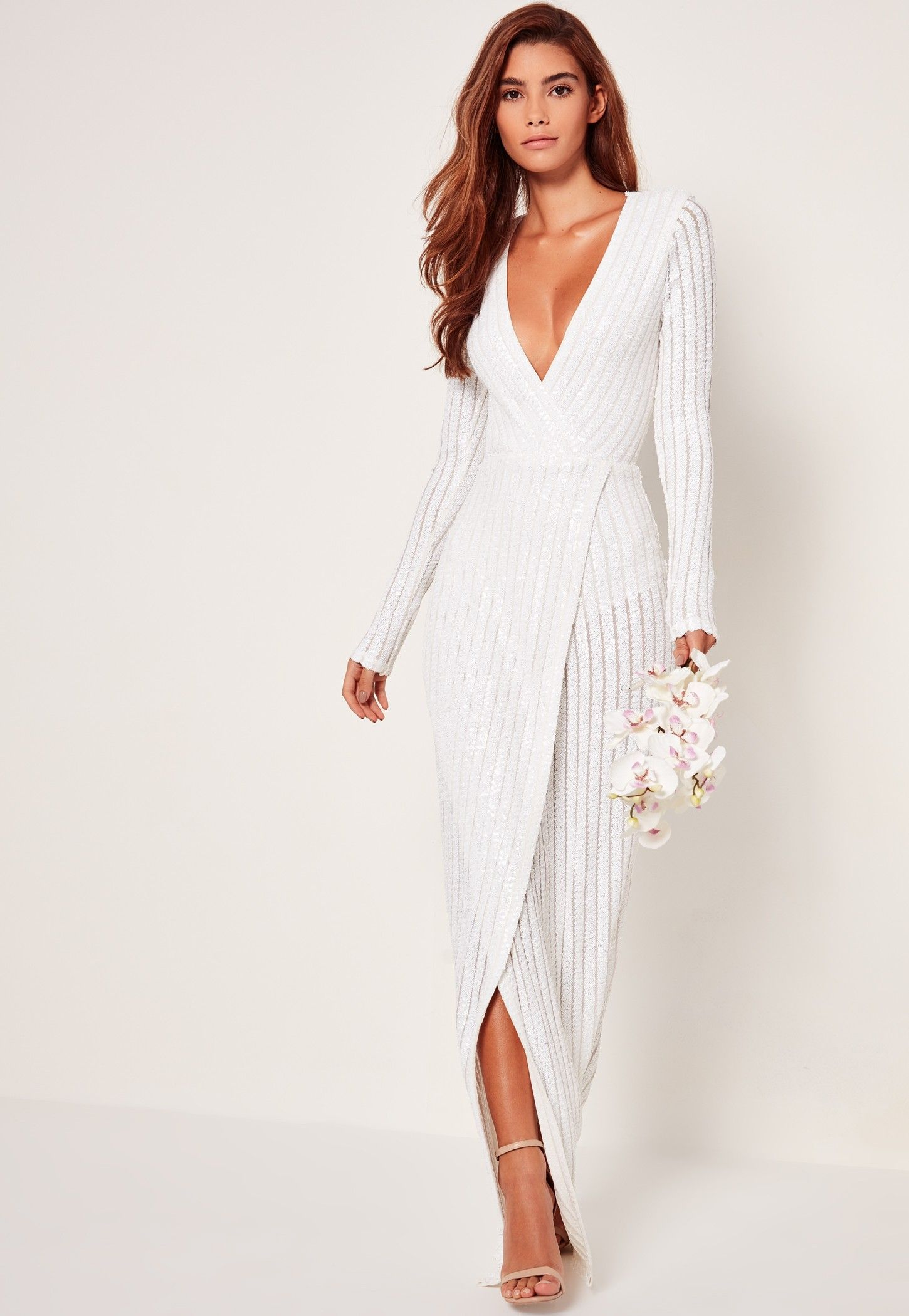 68c04f5112a672 Brides and sequins totally go! Go for this classic white wedding dress in a maxi  length and un-traditional wrap design to the front.