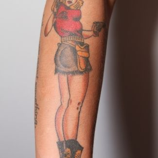 Pin Up Chick- Right arm: I always wanted a pin up chick. I went to my local tat spot and found the one I wanted and boom! She was placed perfectly. I named her Dakota Mayweathers. (Don't ask)