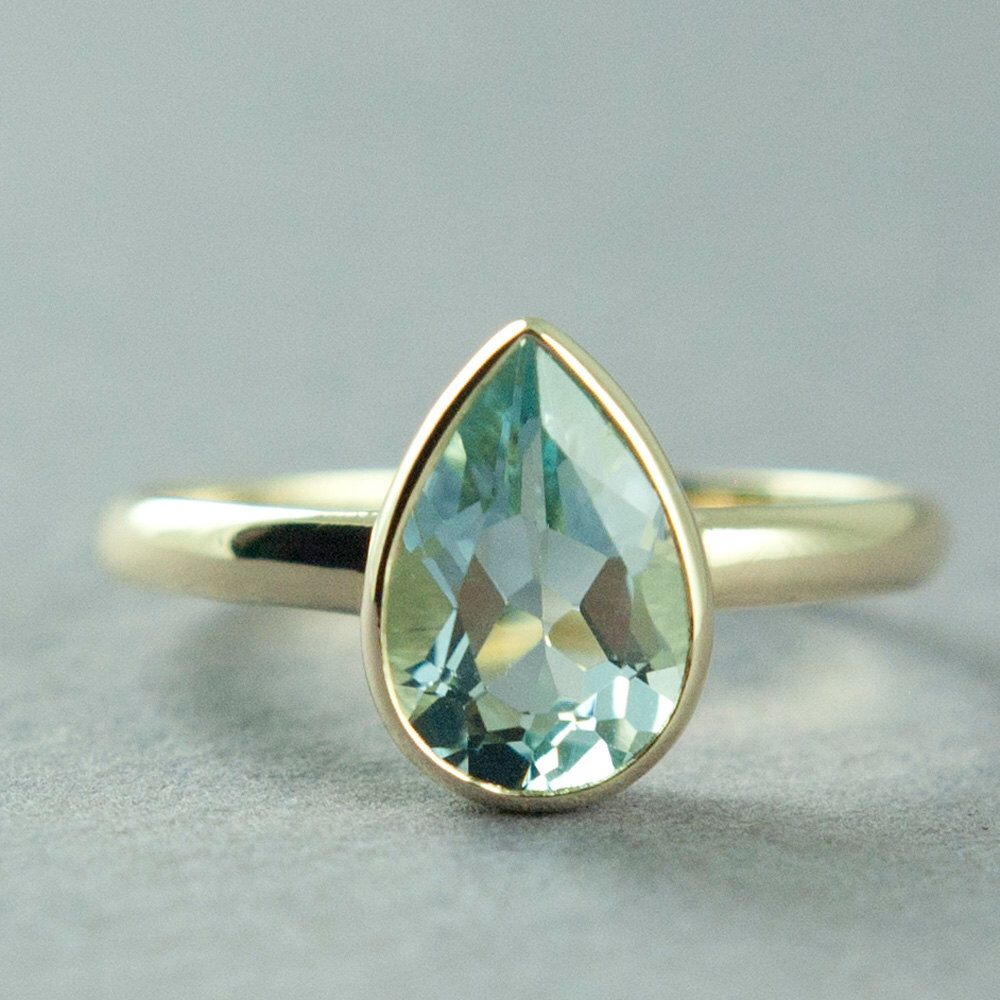Gold Blue Topaz Ring, Solid Gold Ring, Pear Cut Stone, Topaz Solitaire Ring, 14K or 18K Gold Ring, Made to Order, Free Courier Shipping by BlackLotusDesign on Etsy https://www.etsy.com/listing/386673294/gold-blue-topaz-ring-solid-gold-ring