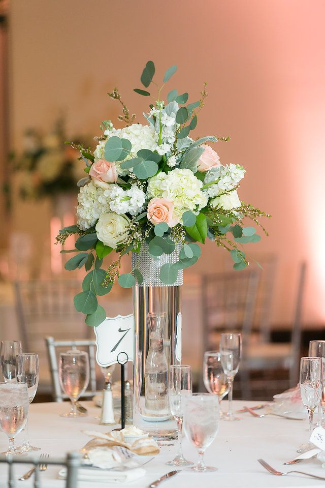 Gorgeous Flower Centerpieces Greenery And Blush Flowers In Tall Glass Vases Glass Wedding Centerpieces Flower Centerpieces Wedding Tall Flower Centerpieces