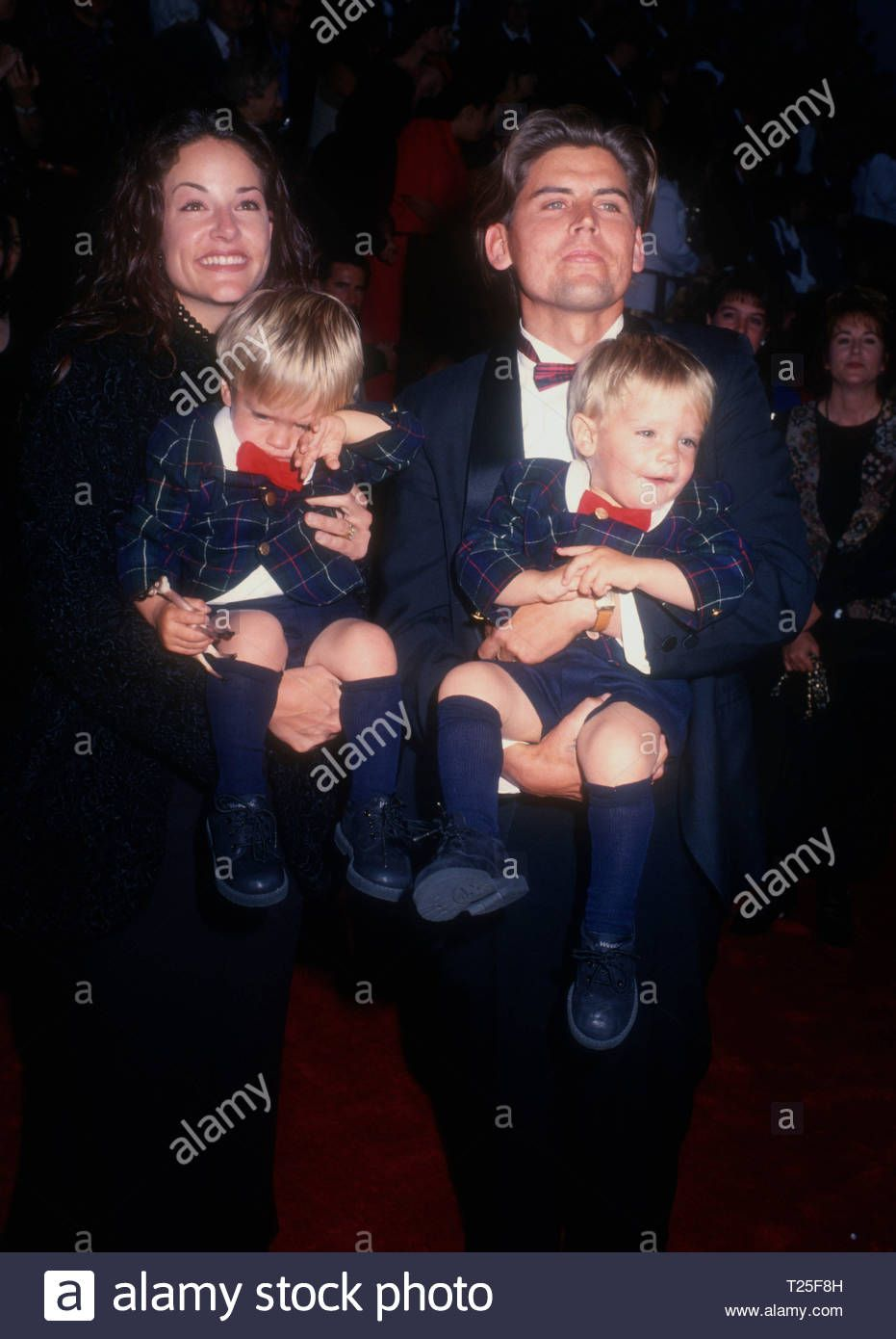 Stock Photo - CULVER CITY, CA - MARCH 8: Actors brothers Dylan Sprouse and Cole Sprouse and parents Melanie Wright and Matthew Sprouse attend the 20th Annual People's Choice Awards on March