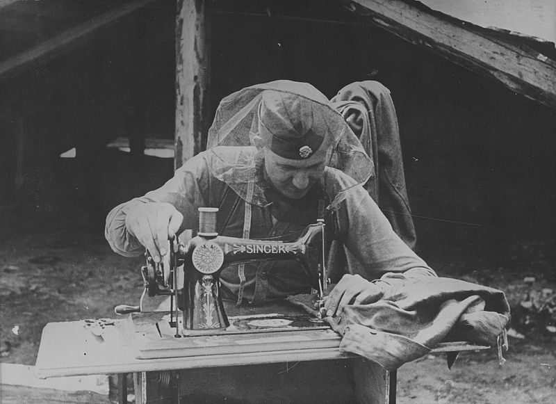 1942 Russia, This waffen-SS soldier protected by a mosquito net when he sews