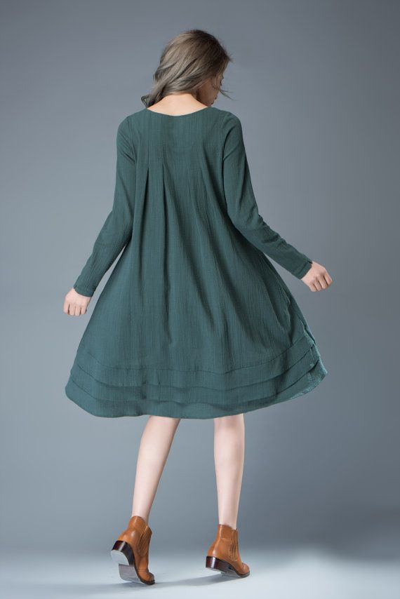 Super feminine and sophisticated, this soft teal linen dress is a must-have for any summer wardrobe. Wear it with a pure silk stole to give it a classy look or chunky boho jewelry for a more casual look. Youll create an entrance wherever you go with this beautifully flowing linen dress with asymmetrical hemline. Flaunting a triple layered design of soft linen at the bottom, the dress is loose-fitting and suitable for plus size ladies. The dress has long sleeves and a round a neck.  You may…