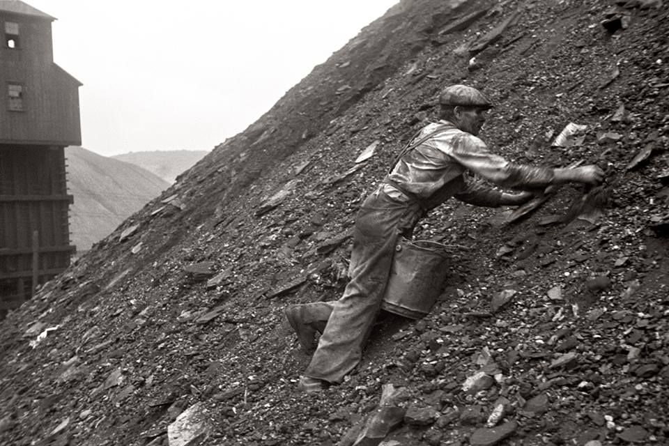 Hazards Of Coal Slag : Man salvaging coal from the slag heap in nanty glo