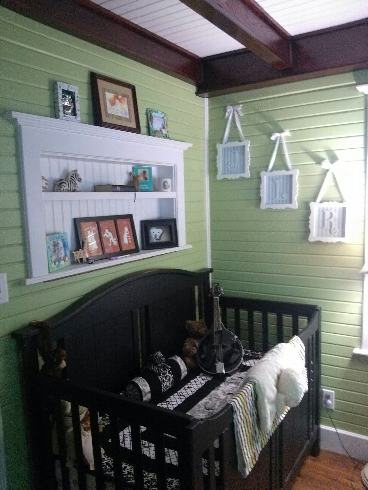 Remodeled baby room. Raised the ceiling, and added beams. Shelves inserted into the walls are a great idea for small spaces. Love the color we picked too:)
