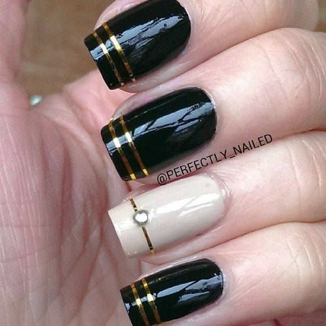 Black nail art designs can instantly add glamour to your look. We have  collected all different type of black nail art designs you will surely love  to try. - Black & Gold, With One White & Gold NAIL'D IT Pinterest Black