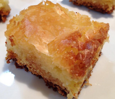 Ingredients: 1 (18.25 ounce) package yellow cake mix 1/2 cup butter, melted 2 eggs 1 teaspoon vanilla extract 1 (8 ounce) package cream cheese 2 eggs 1 teaspoon vanilla extract 4 cups confectioners' sugar Directions: Preheat oven to 350 degrees F (175 degrees C). Mix cake mix, melted butter or margarine, 1 teaspoon vanilla, and 2 eggs with a spoon. Pat into a 9 X 13 inch pan. Mix cream cheese, 2 eggs, and 1 teaspoon vanilla with an electric mixer. Slowly beat in confectioner's sugar. Pou...