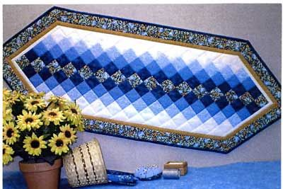 Easy quilted table runner pattern a step by step guide pinteres sewing pattern for a quilted colorwash tablerunner designed by connie ewbank of butterfly stitches watchthetrailerfo