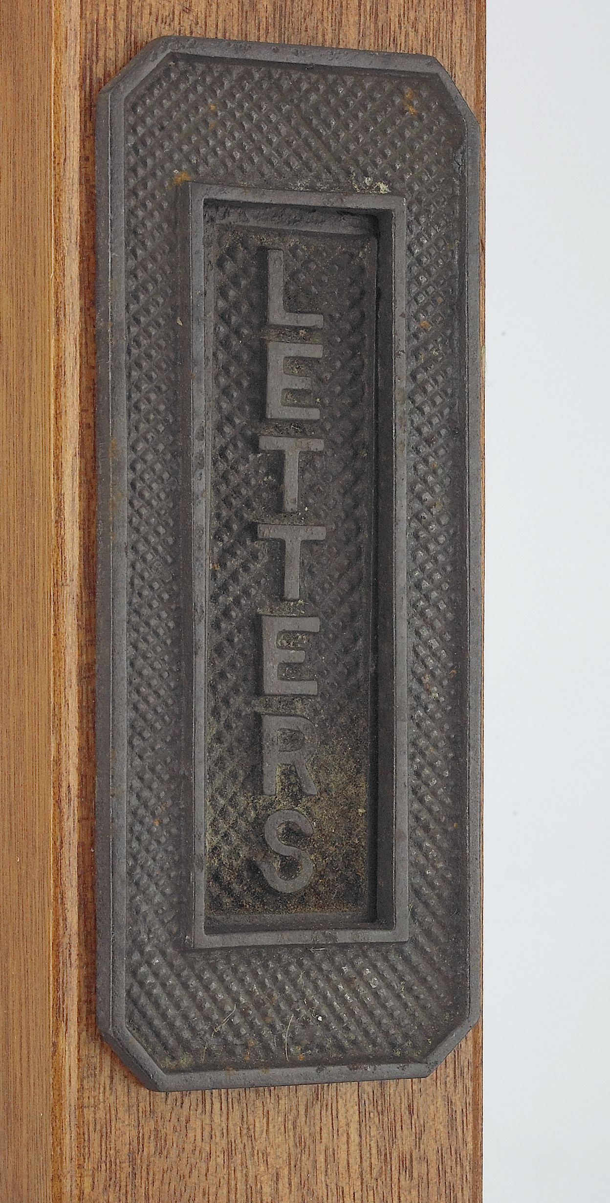 or if you prefer something simpler we have a lovely vertical cast iron letter plate