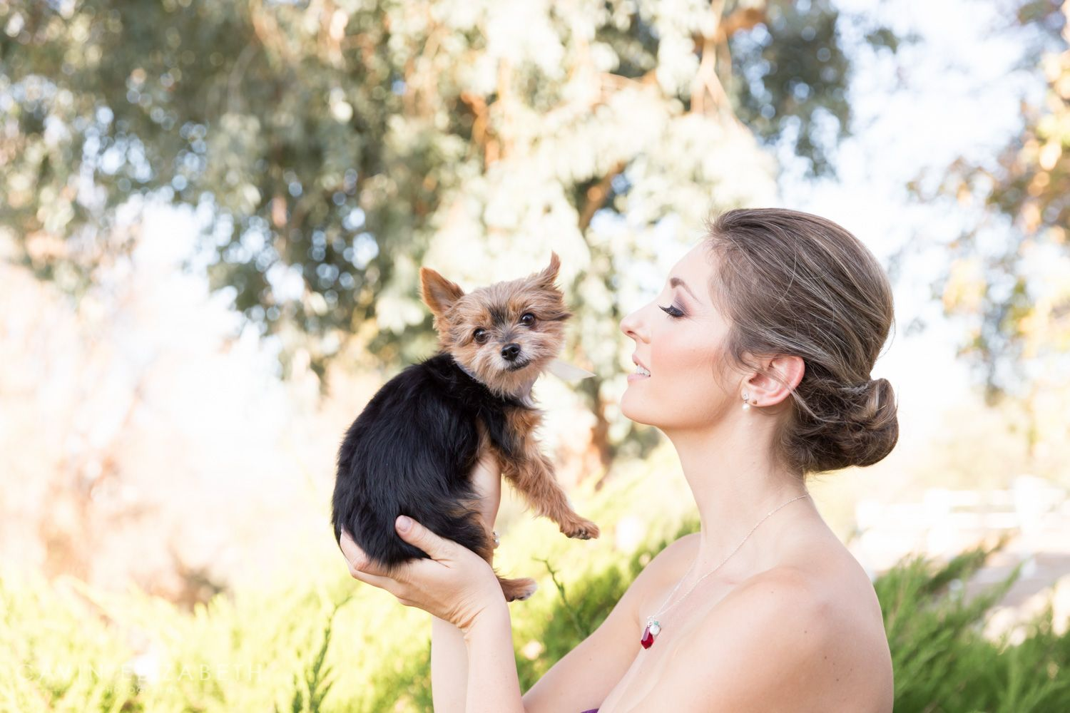 Tea Party Themed Wedding from a San Diego wedding photographer. Wedding inspiration and planning ideas. Styled shoot in California. Adorable picture of a bride and dog, Cavin Elizabeth Photography