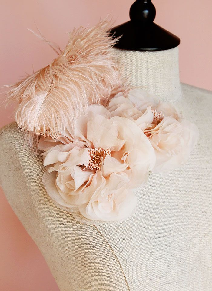 Cosette is hand dyed silk chiffon in double bloom. Blush ostrich plumes curl gently over and dance upon a sway.Created with antique flower tools for added romance. Center stamens are hand dyed.Attaches with a silver metal comb for ease of use.Ready to ship.