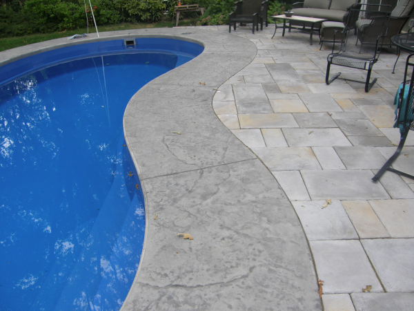 Fiberglass cantilevered concrete coping pool stuff in - Installing pavers around swimming pool ...