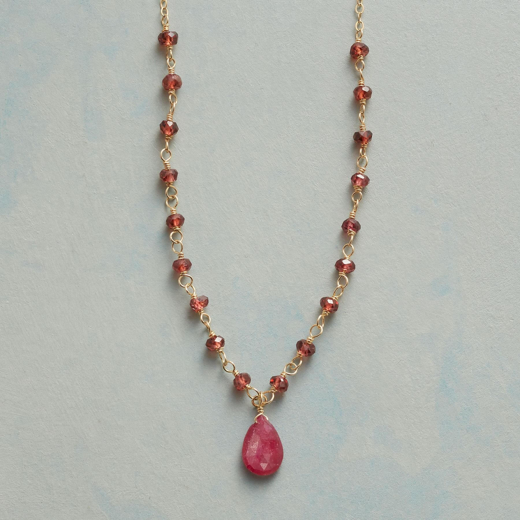 WITH GRACE NECKLACE -- Wire-wrapped by hand, petite garnets grace a ...