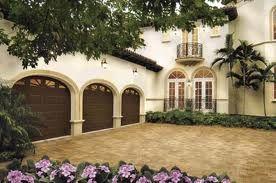 Three Car Garage Attched To A Beautiful Mediterranean Style Home Garage Door Installation
