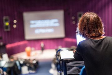 Conference and Presentation Audience at the conference hall Business and Entrepreneurship Faculty lecture and workshop Focus on unrecognizable person in audience making n...