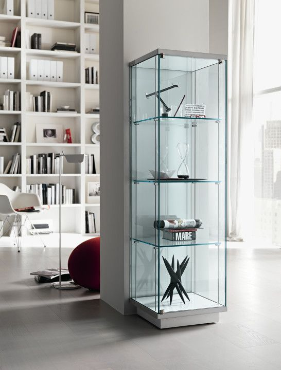 Interior Corner Design Of The Glass Display Cabinet Having Some Unique Stuffs Inside Framed By The Stee Glass Cabinets Display Glass Display Unit Glass Shelves